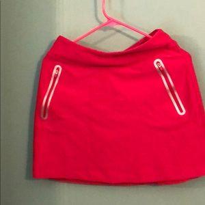 Pink Nike golf skort
